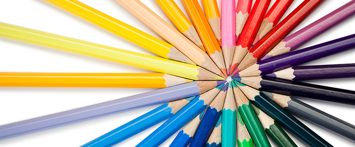 colored pencils in all colors arranged artistically.